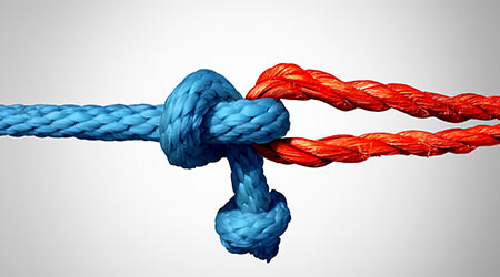 Connected concept as two different ropes tied and linked together as an unbreakable chain as a trust and faith metaphor for dependence and reliance on a trusted partner for support and strength