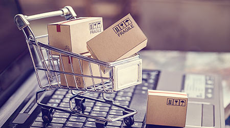 Boxes in a trolley on a laptop keyboard. Ideas about online shopping, online shopping is a form of electronic commerce that allows consumers to directly buy goods from a seller over the internet