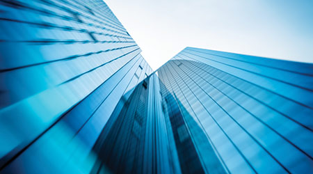 steel light blue background of glass high rise building skyscraper commercial modern city of future