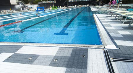 Flooring around facility swimming pool