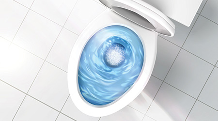 Top view of toilet bowl, blue detergent flushing in it