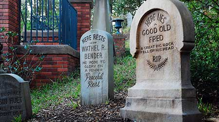 The entrance to the Haunted Mansion is lined with humorous tombstones