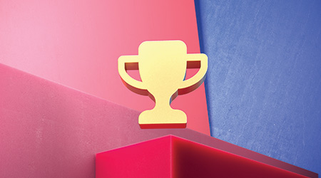 Golden Trophy Icon on the Blue and Pink Geometric Background