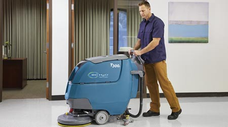 Man uses floor machine