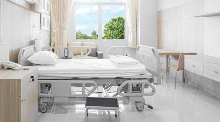 clean hospital room with bed and clean surfaces