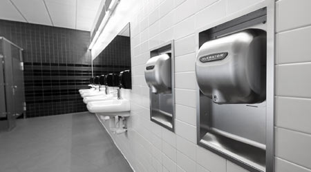 restroom with hand dryer and sinks