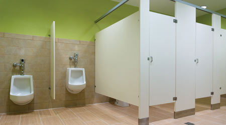 school restroom with urinal and tilet stalls