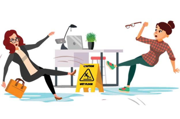 women in office slip on wet floor in front of a caution wet floor sign