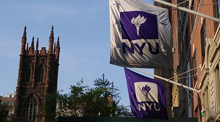 New York University flags outside of building