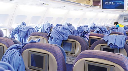 Cleaning staffs clean inside the cabin of commercial airplane