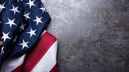Overhead View Of American Flag On Dark Concrete Background