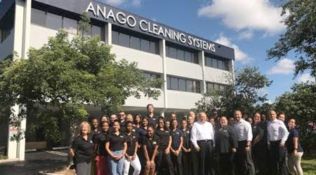Anago Cleaning Systems employees in front of the company's new HQ building
