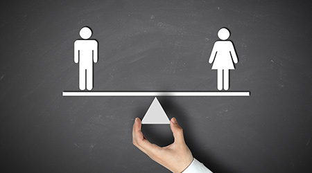 Male equals female concept with businessman hand holding against blackboard background