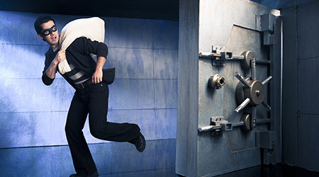 thief running out of a bank vault