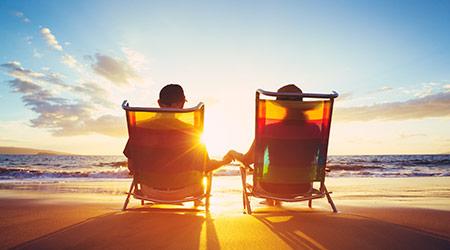 Couple enjoying retirement on a beach