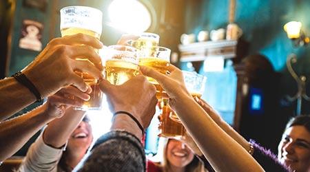 People toasting beers