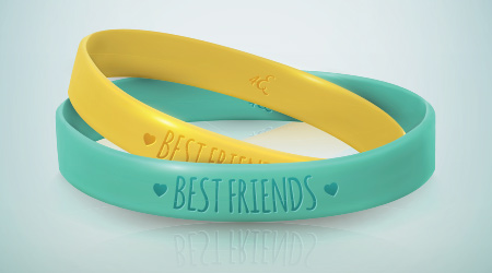 Happy Friendship Day. Realistic yellow and turquoise rubbers friendship bracelets for best friends. Beautiful greeting card for holiday and celebration friends day