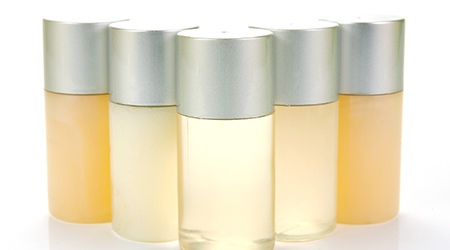 Miniature shampoo bottles isolated against a white background