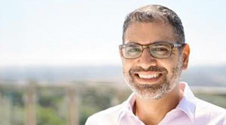 Man in glasses smiles
