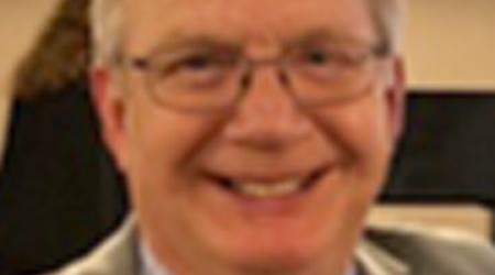 Headshot of a retiring old man