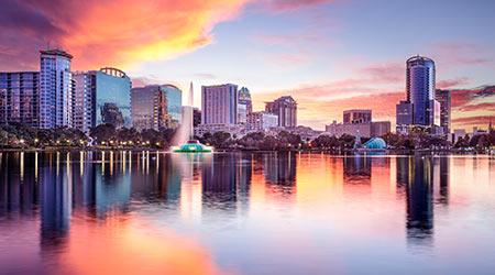 Orlando, Florida, USA downtown city skyline from Eola Park