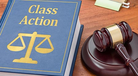 A law book with a gavel - Class action