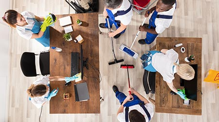 Overhead View Of Diverse Janitors In Uniform Cleaning The Office With Cleaning Equipments