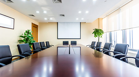 A board room with an empty table