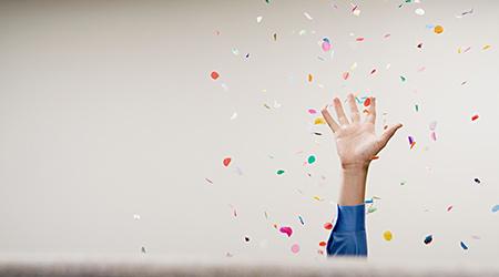 Businessman throwing confetti in the air