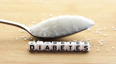 Pile of sugar next to diabetes spelt out