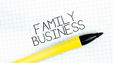 FAMILY BUSINESS concept write text on notebook