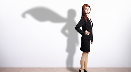 Superhero Business Woman with white wall background