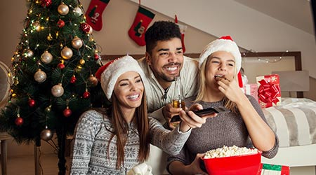 Friends watching movie and having fun on Christmas Eve