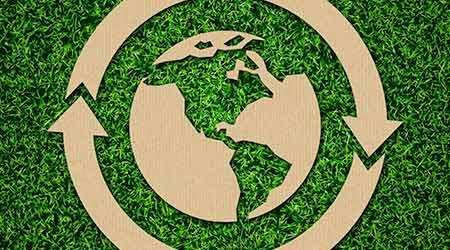 Green Energy Iconic Symbols on Green Grass