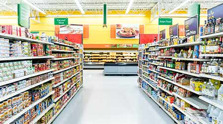 grocery store aisle with stocked shelves and clean floor