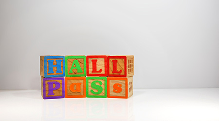 "Stylized shot of ""Hall Pass"" spelled out with ABC block"