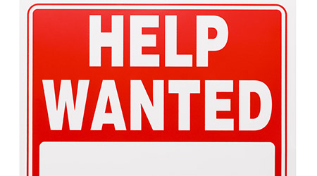 Red and White Plastic Help Wanted Sign With Copy Space Isolated on White Background