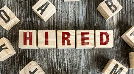 Wooden Blocks with the text: Hired