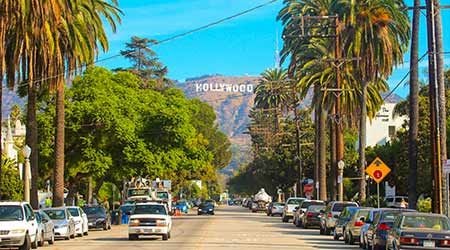 Hollywood sign district in Los Angeles, USA. Beautiful Hollywood highway road with cars