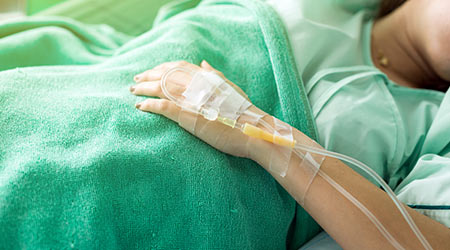 Close up of a woman patient in hospital with saline intravenous.