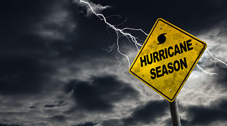 Hurricane season with symbol sign against a stormy background and copy space.