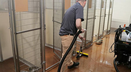 floor cleaning with machine in dog kennel