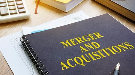 Book about Merger And Acquisitions M&A on a desk