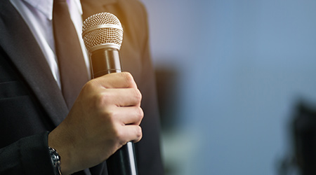 blurred of smart businessman speech, talking with microphone in seminar conference meeting hall