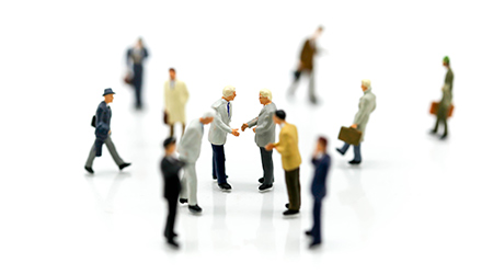 Miniature people : Businessmans make handshaking agreement with the big group of the small business
