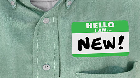 """Name tag that reads """"new hire"""""""