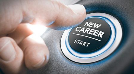 Finger pressing a new career start button.
