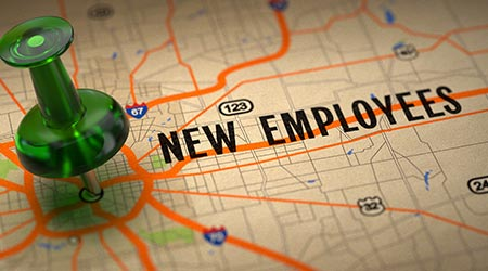 New Employees Concept - Green Pushpin on a Map Background with Selective Focus