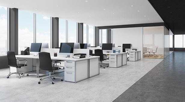 Side view of white and black open space office interior with rows of computer tables with desktops standing on them