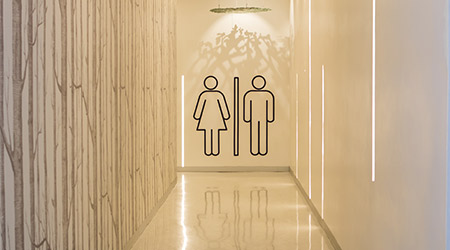 toilet wc restroom sign men and woman icon graphic on wall